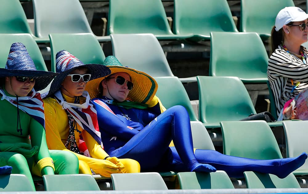Tennis fans watch the first round match between Camila Giorgi of Italy and Storm Sanders of Australia at the Australian Open tennis championship in Melbourne, Australia.