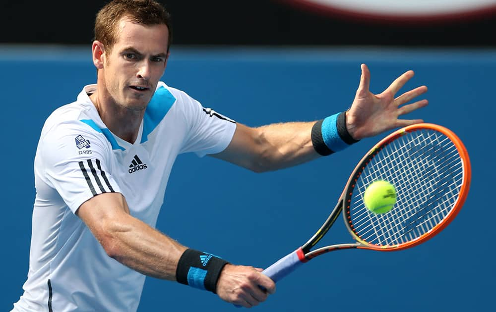 Andy Murray of Britain makes a backhand return to Go Soeda of Japan during their first round match at the Australian Open tennis championship in Melbourne, Australia.