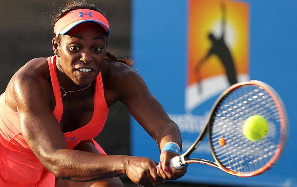 Sloane Stephens of the U.S. makes a backhand return to Yaroslava Shvedova of Kazakhstan during their first round match at the Australian Open tennis championship in Melbourne, Australia.