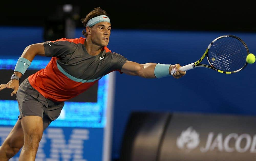 Rafael Nadal of Spain makes a forehand return to Bernard Tomic of Australia during their first round match at the Australian Open tennis championship in Melbourne, Australia.