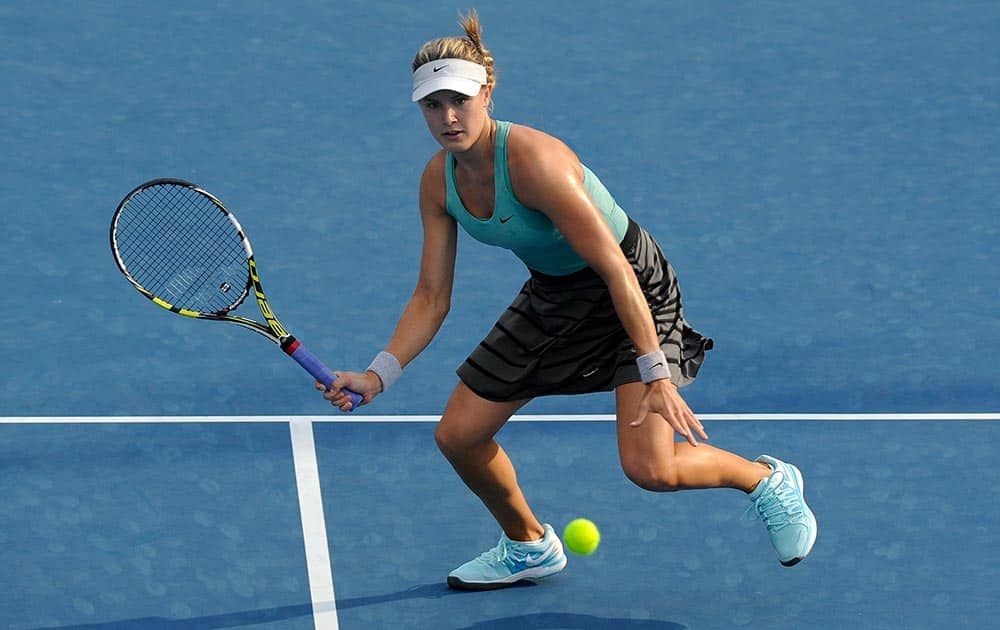 Eugenie Bouchard of Canada eyes the ball to return to Virginie Razzano of France during their second round match at the Australian Open tennis championship in Melbourne, Australia.
