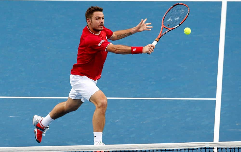 Stanislas Wawrinka of Switzerland makes a backhand return to Alejandro Falla of Colombia during their second round match at the Australian Open tennis championship in Melbourne, Australia.