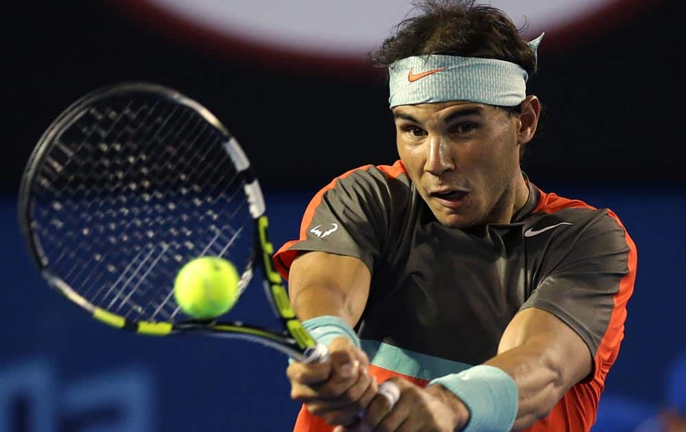 Rafael Nadal of Spain makes a backhand return to Thanasi Kokkinakis of Australia during their second round match at the Australian Open tennis championship in Melbourne, Australia.