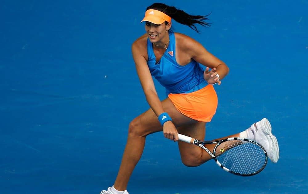 Garbine Muguruza of Spain makes a forehand return to Caroline Wozniacki of Denmark during their third round match at the Australian Open tennis championship in Melbourne, Australia.