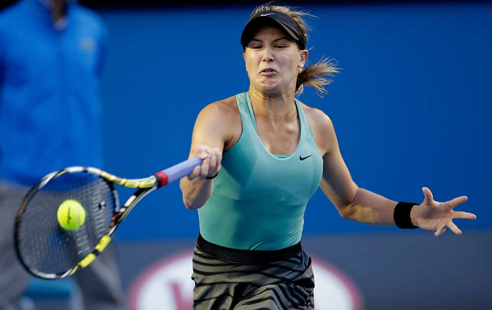 Eugenie Bouchard of Canada makes a forehand return to Casey Dellacqua of Australia during their fourth round match at the Australian Open tennis championship in Melbourne.