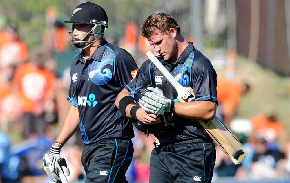 New Zealand's Tim Southee, and Corey Anderson, 68 not out, walk off at the end of their innings of 292 against India in their first one day international cricket match at McLean Park in Napier.