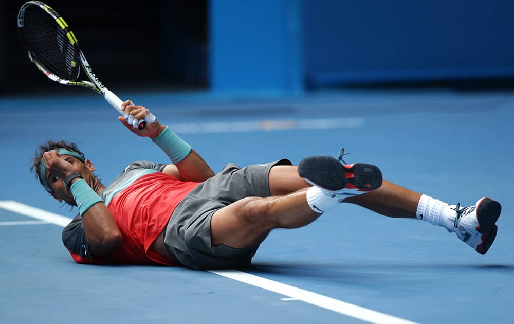 Rafael Nadal of Spain falls as he plays Kei Nishikori of Japan during their fourth round match at the Australian Open tennis championship in Melbourne, Australia.