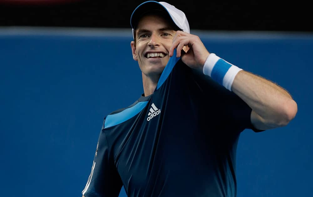 Andy Murray of Britain holds up his shirt during his fourth round match against Stephane Robert of France at the Australian Open tennis championship in Melbourne, Australia.