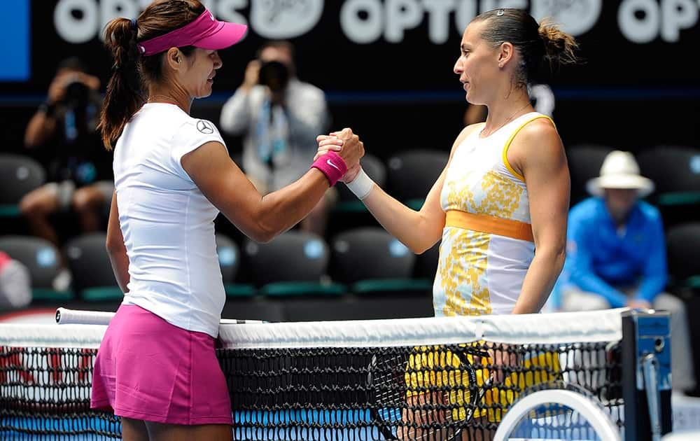 Li Na of China, left, shakes hands with Flavia Pennetta of Italy at the net, after Li won their quarterfinal at the Australian Open tennis championship in Melbourne, Australia.