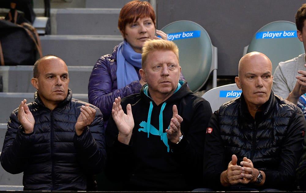 Boris Becker, center, former Grand Slam champion and coach of Novak Djokovic, watches Djokovic's quarterfinal against Stanislas Wawrinka of Switzerland at the Australian Open tennis championship in Melbourne, Australia.