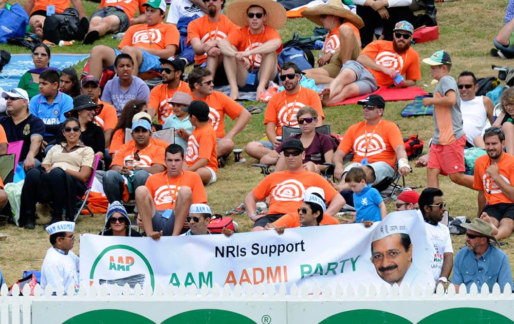 Supporters of an Indian political party use a cricket match between New Zealand and India to promote their cause, at Seddon Park in Hamilton, New Zealand.
