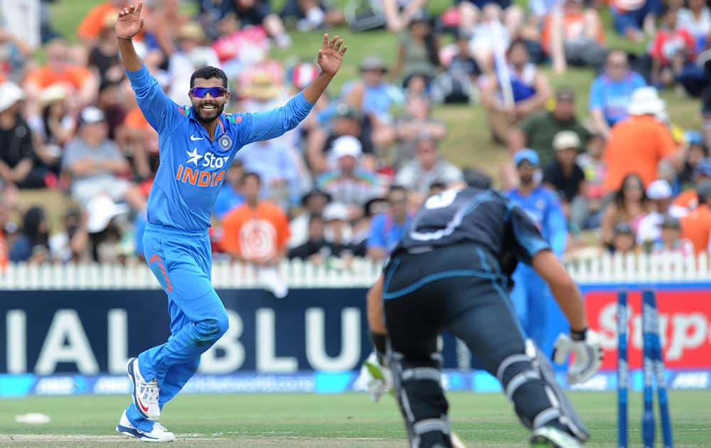 India's Virat Kohli, left, celebrates believing New Zealand's Ross Taylor has been stumped off his bowling in the second one-day International cricket match at Seddon Park in Hamilton, New Zealand.