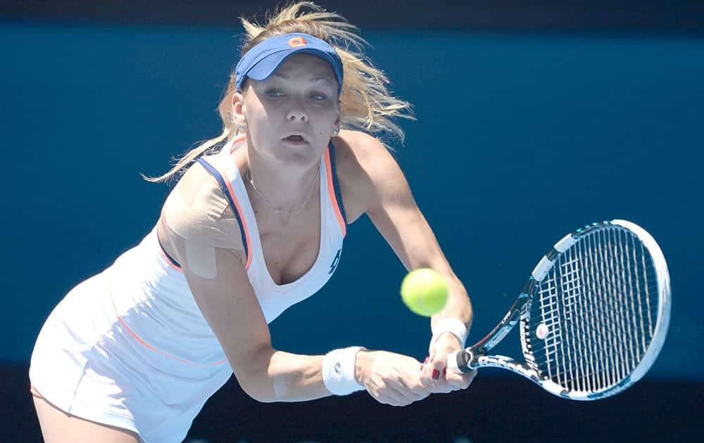 Agnieszka Radwanska of Poland makes a backhand return to Victoria Azarenka of Belarus during their quarterfinal at the Australian Open tennis championship in Melbourne.