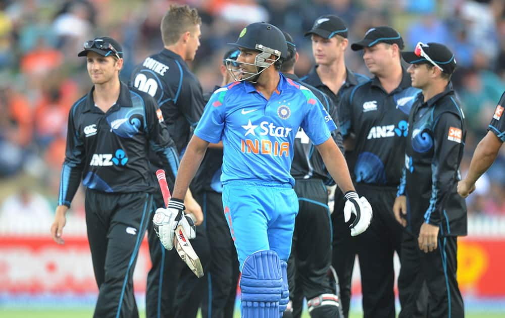 India's Rohit Sharma looks back after being dismissed by New Zealand's Tim Southee for 20 in the second one day International cricket match at Seddon Park in Hamilton, New Zealand.