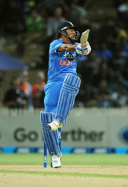 India's MS Dhoni hooks against New Zealand during their second one-day international cricket match, at Seddon Park, in Hamilton, New Zealand.
