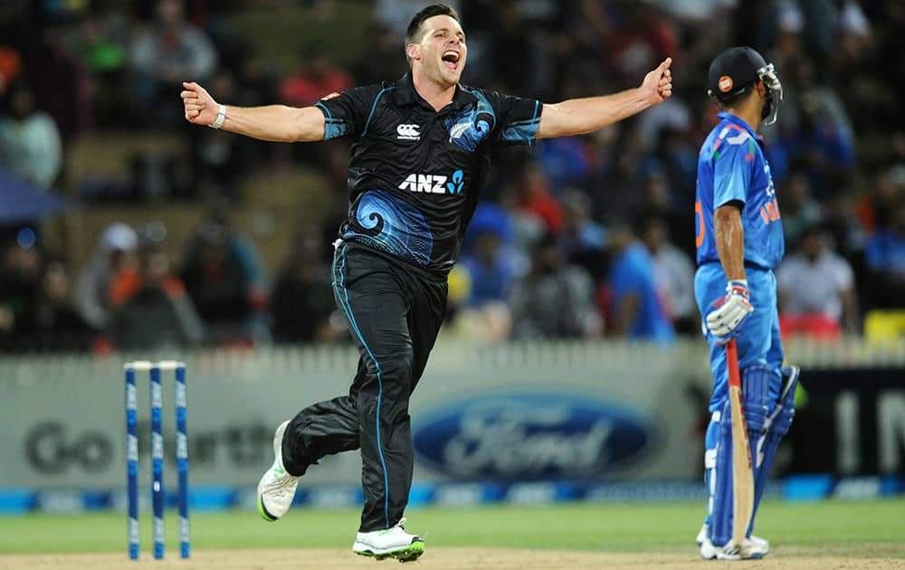 New Zealand's Mitchell McClenaghan celebrates the wicket of India's Ajinkya Rahane for 36 during their second one-day international cricket match, at Seddon Park, in Hamilton, New Zealand.