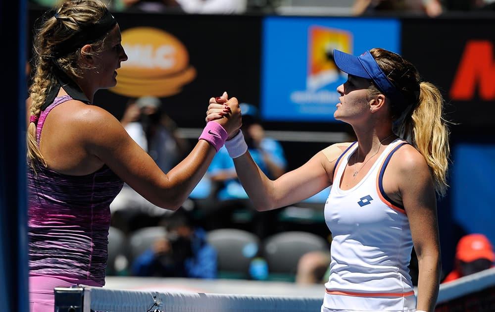 Agnieszka Radwanska of Poland, right, shakes hands with Victoria Azarenka of Belarus at the net after Radwanska won their quarterfinal at the Australian Open tennis championship in Melbourne, Australia.