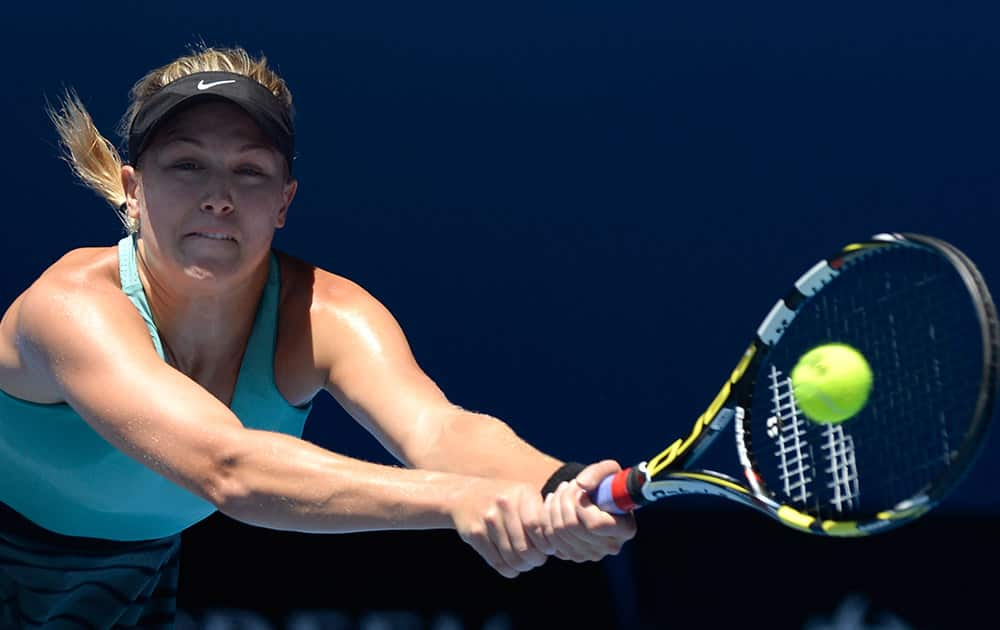Eugenie Bouchard of Canada makes a backhand return to Li Na of China during their semifinal at the Australian Open tennis championship in Melbourne, Australia.