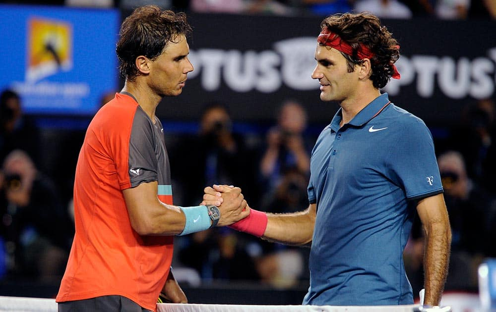 Rafael Nadal of Spain, left, is congratulated by Roger Federer of Switzerland at the net after Nadal won their semifinal final at the Australian Open tennis championship in Melbourne.