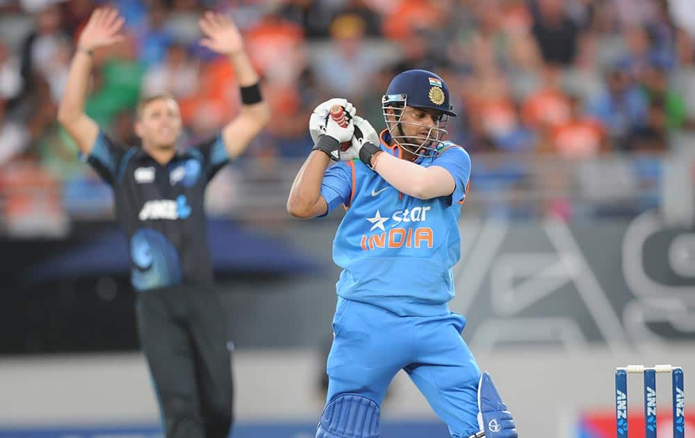 Suresh Raina out to New Zealand's Tim Southee for 39 during the third one day International cricket match at Eden Park in Auckland, New Zealand.