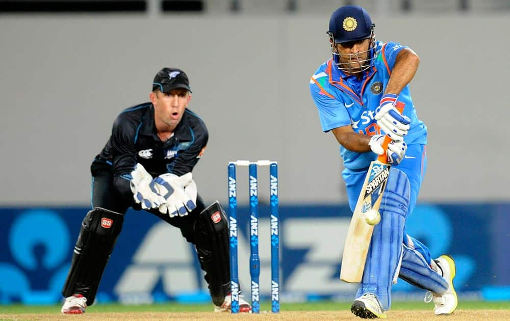MS Dhoni bats in front of New Zealand's Luke Ronchi in their third one day international cricket match at Eden Park in Auckland.