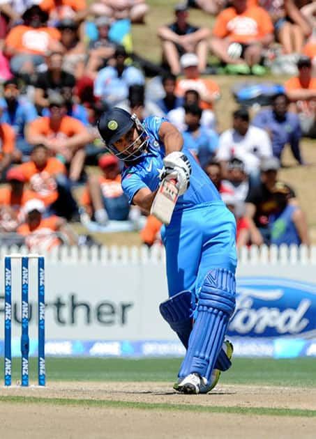 India's Rohit Sharma hits a six against New Zealand in the fourth one-day international cricket match at Seddon Park in Auckland.