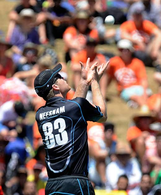 New Zealand's James Neesham prepares to take the catch to dismiss India's Virat Kohli for 2 in the fourth one-day international cricket match at Seddon Park in Auckland.