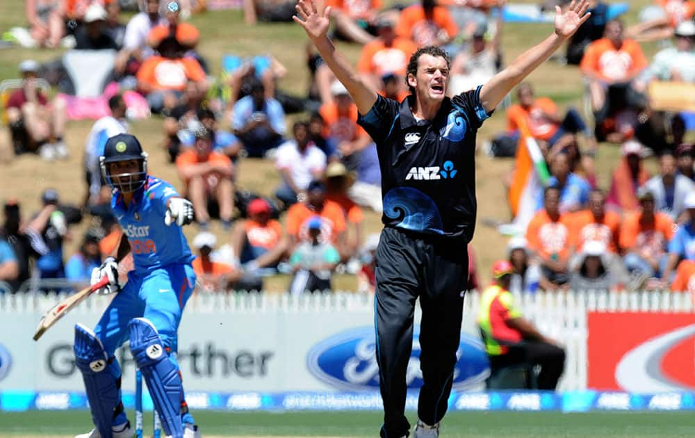 New Zealand's Kyle Mills, right, appeals unsuccessfully for the wicket of India's Virat Kohli in the fourth one-day international cricket match at Seddon Park in Auckland.