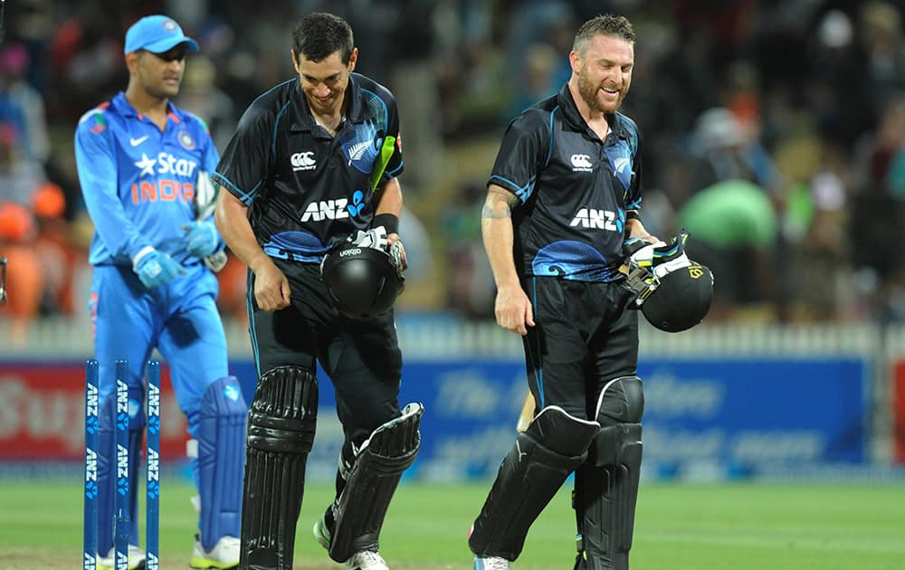 New Zealand's Ross Taylor and Brendon McCullum walk together after their series win over India in the fourth one day International cricket match at Seddon Park in Hamilton, New Zealand.