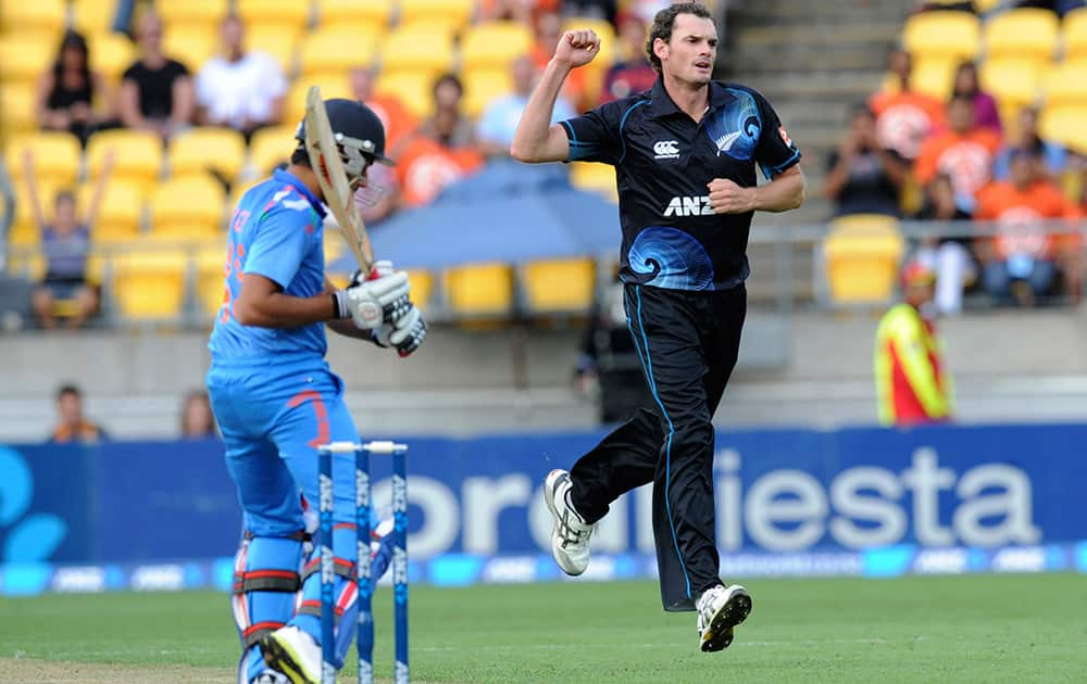 New Zealand's Kyle Mills celebrates after India's Rohit Sharma was caught behind by Ross Taylor for 4 in their fifth one day international cricket match at Westpac Stadium in Wellington, New Zealand.