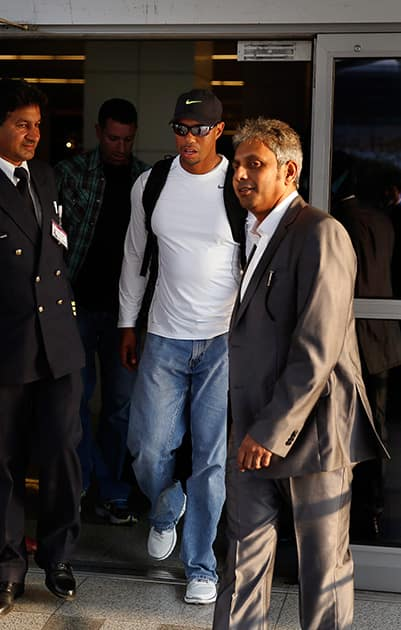 Tiger Woods arrives at the Indira Gandhi International airport, in New Delhi. Woods arrived Monday on his first visit to India to play an exhibition with a top business executive.