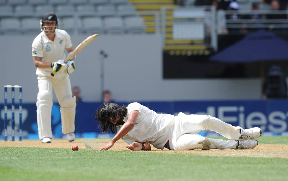 India's Ishant Sharma dives to save the ball off the bat of New Zealand's Brendon McCullum on the first day of the first cricket test at Eden Park in Auckland, New Zealand.