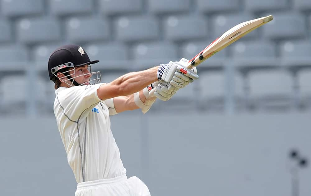 New Zealand's Kane Williamson hits a six to the boundary against India on the first day of the first cricket test at Eden Park in Auckland, New Zealand.