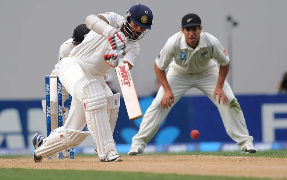 Shikar Dhawan bats against New Zealand on the third day of the first cricket test at Eden Park in Auckland, New Zealand.