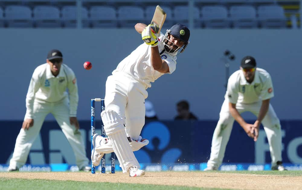 India's Ravindra Jadeja hits out to be caught by New Zealand's Ish Sodhi for 26 on the fourth day of the first cricket test at Eden Park in Auckland, New Zealand.