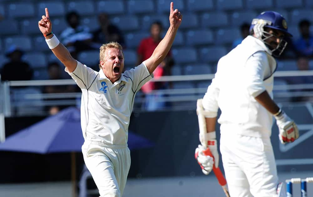 New Zealand's Neil Wagner celebrates the dismissal off his bowling of India's Zaheer Khan for 26 on the fourth day of the first cricket test at Eden Park in Auckland, New Zealand.