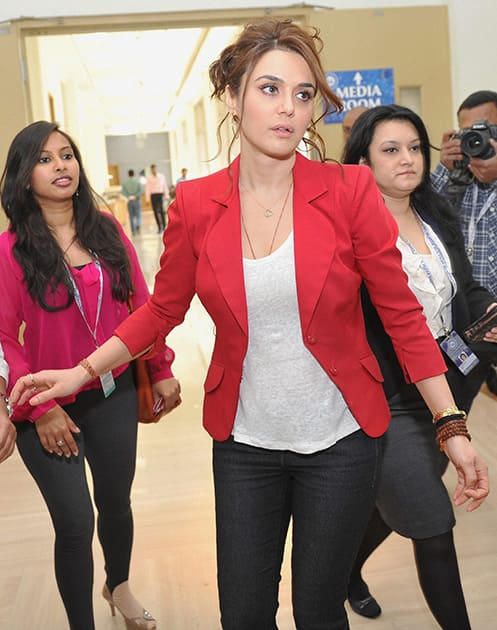 Preity Zinta, Co-owner of Kings XI Punjab arrives to attend a press conference during the IPL Auction 2014 in Bengaluru.