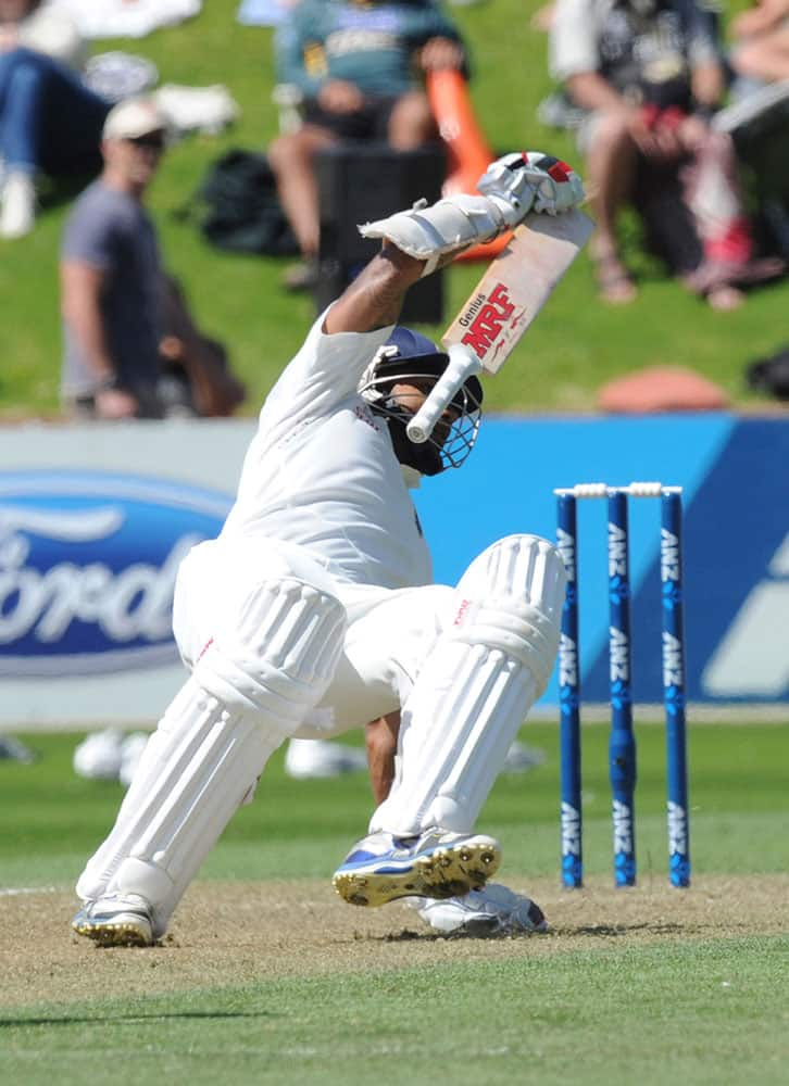 India's Shikar Dhawan stumbles as he attempts to return to his crease against New Zealand on the second day of the second cricket test in Wellington, New Zealand.