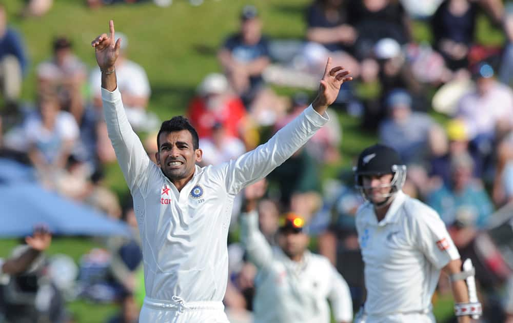 India's Zaheer Khan celebrates after trapping New Zealand's Peter Fulton lbw for 1 on the second day of the second cricket test in Wellington, New Zealand.