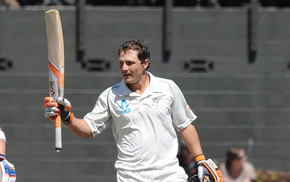 New Zealand's BJ Watling celebrates his century against India in the second innings on the fourth day of the second cricket test at Basin Reserve in Wellington, New Zealand.