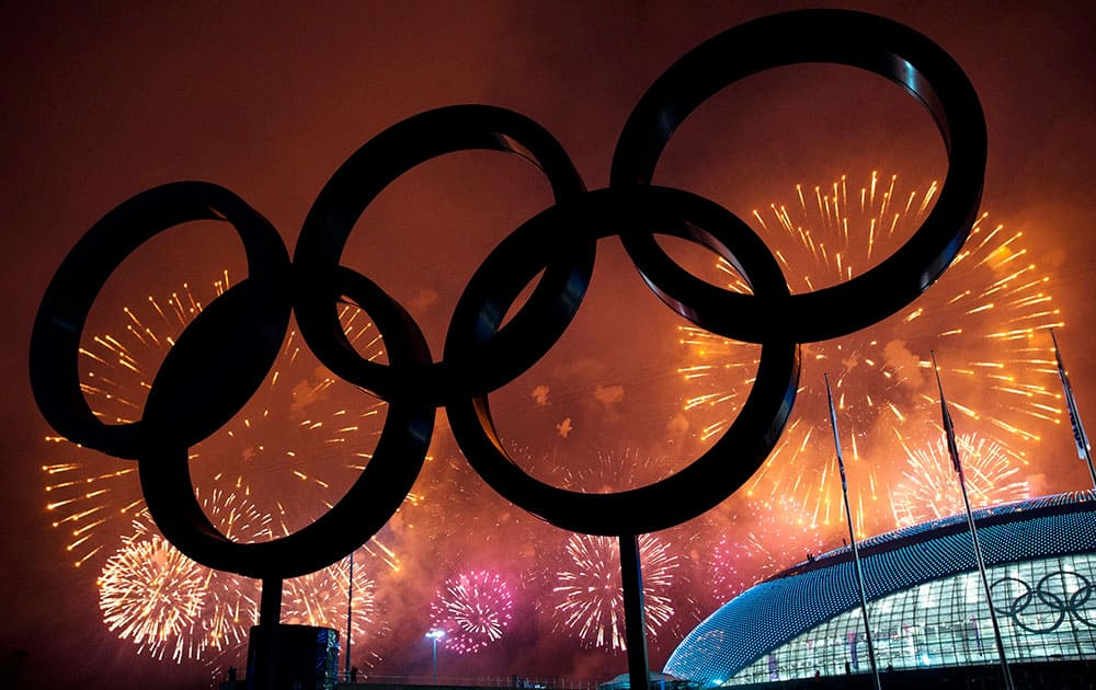 The Olympic Rings are silhouetted as fireworks light up the sky during the closing ceremonies at the 2014 Sochi Winter Olympics.