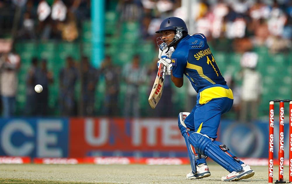 Sri Lanka's Kumar Sangakkara plays a shot during the opening match of the Asia Cup one-day international cricket tournament against Pakistan in Fatullah, near Dhaka, Bangladesh.