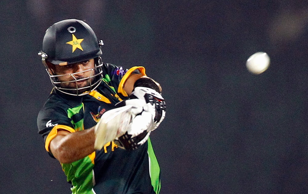 Pakistan's Ahmed Shehzad plays a shot during the opening match of the Asia Cup one-day international cricket tournament against Sri Lanka in Fatullah, near Dhaka, Bangladesh.