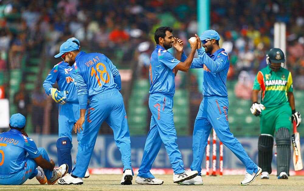 Mohammad Shami, center with a ball, celebrates with teammates for the dismissal of Bangladeshi Shamsur Rahman during the Asia Cup one-day international cricket tournament in Fatullah, near Dhaka, Bangladesh.