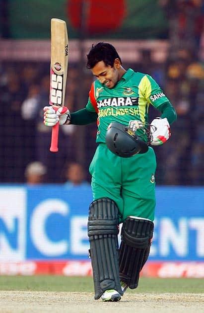 Bangladesh's Mushfiqur Rahim celebrates after scoring a century during the Asia Cup one-day international cricket tournament against India in Fatullah, near Dhaka, Bangladesh.