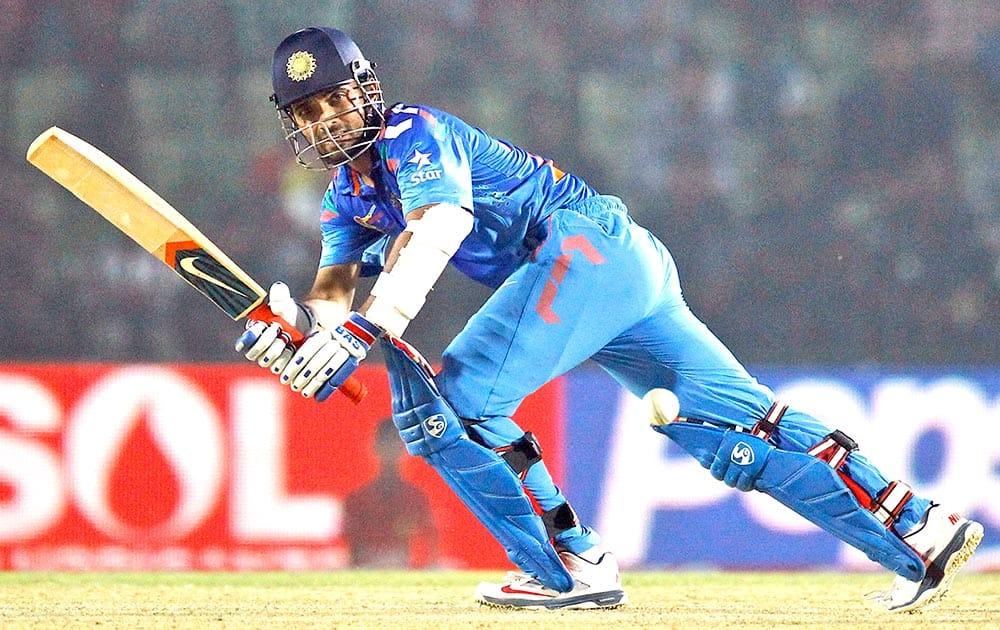 India's Ajinkya Rahane plays a shot during the Asia Cup one-day international cricket tournament against Bangladesh in Fatullah, near Dhaka, Bangladesh.