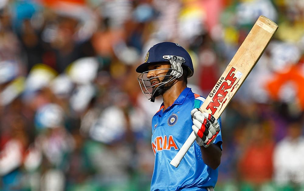 India's Shikhar Dhawan acknowledges the crowed after scoring fifty runs during the Asia Cup one-day international cricket tournament against Sri Lanka in Fatullah, near Dhaka, Bangladesh.