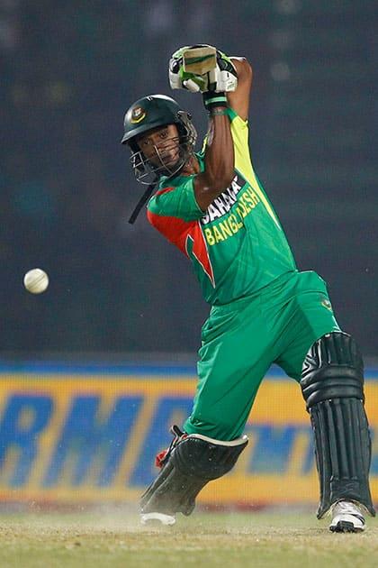 Bangladesh's Naeem Islam plays a shot during the Asia Cup one-day international cricket tournament against Afghanistan in Fatullah, near Dhaka, Bangladesh.