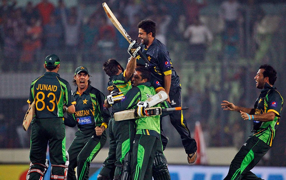 Pakistan's team celebrates after winning the Asia Cup one-day international cricket tournament against India in Dhaka, Bangladesh.