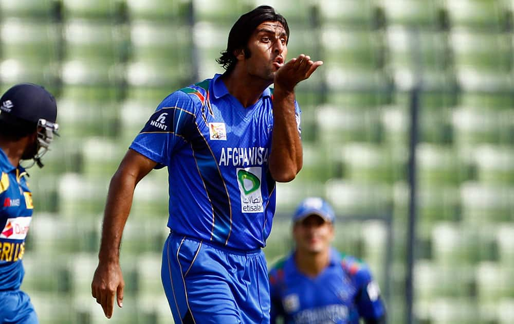 Afghanistan's Shapoor Zadran celebrates after taking the wicket of Sri Lanka's Lahiru Thirimanne during the Asia Cup one-day international cricket tournament between them in Dhaka.